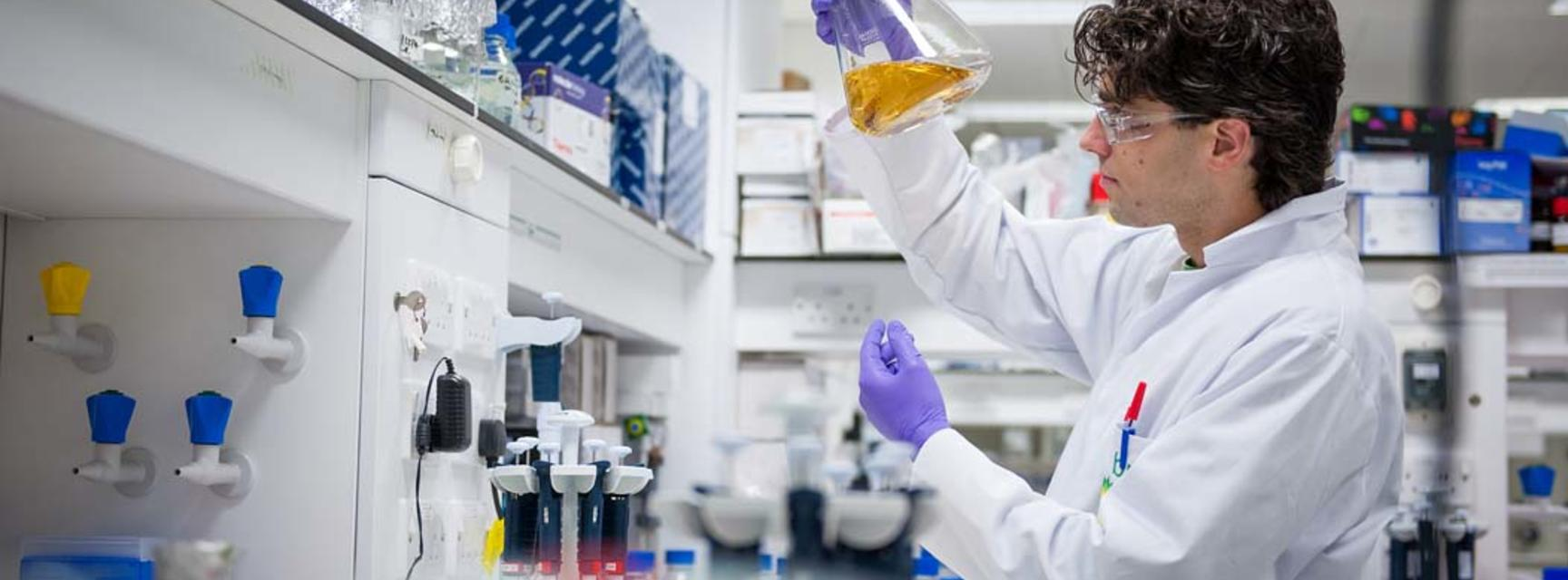 Photo of person in a laboratory carrying out research